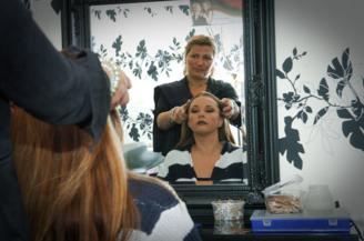 Mikrolåner Rima Zam Zam i sin frisørsalon